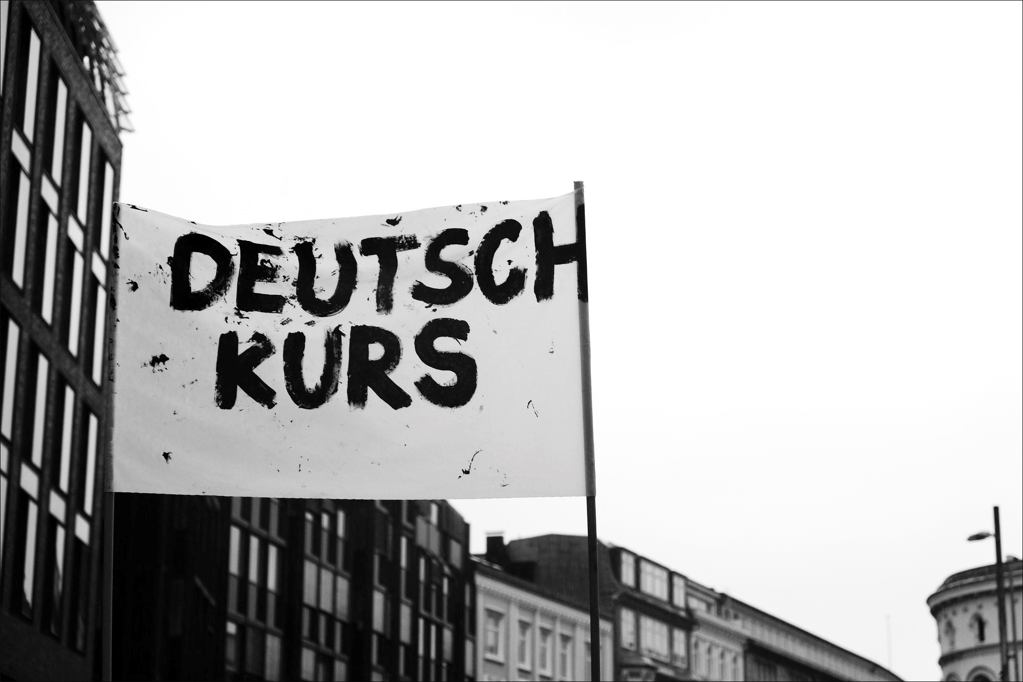 Black and white photo. A white banner with the word